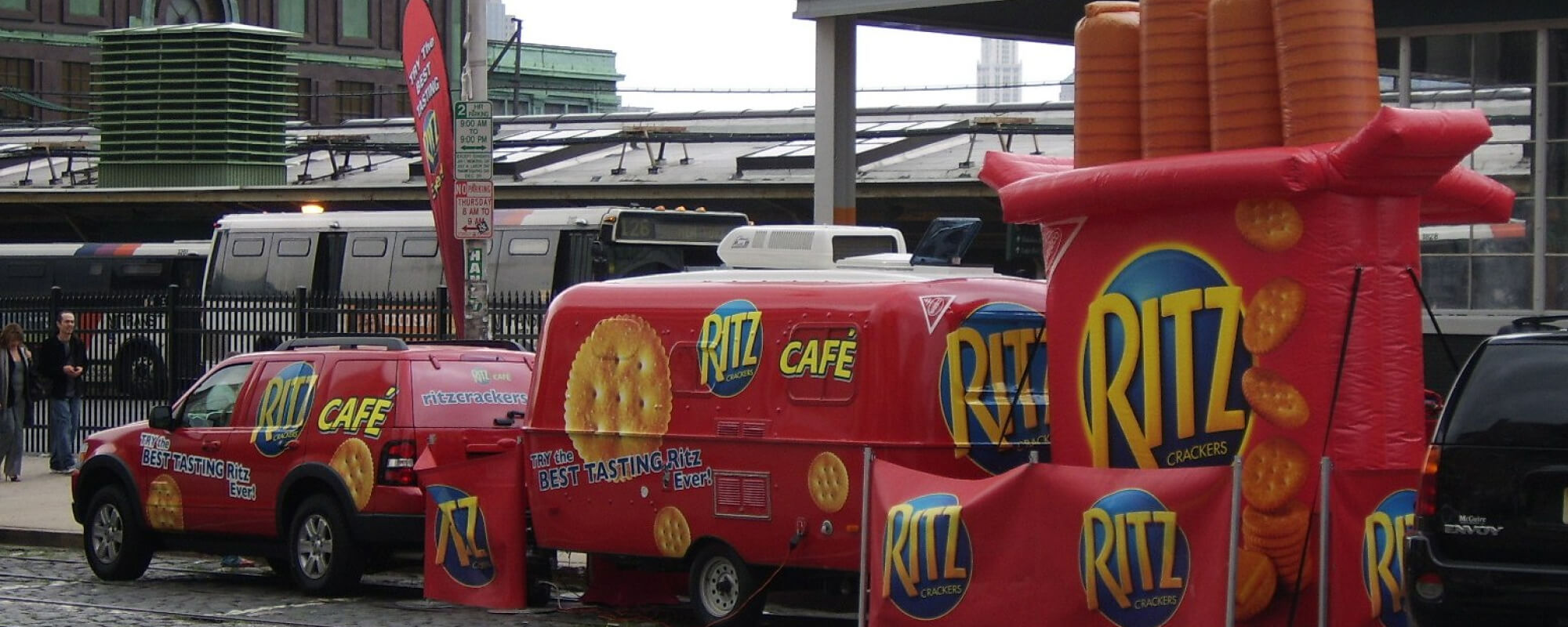 a truck with a trailer, all containing the Ritz logo